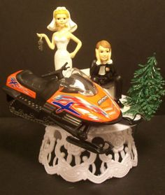 this will so be mine and dustins wedding topper except with a skidoo 800 RS