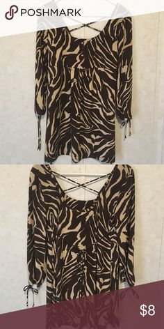 tie  back and tunic. Tie back tunic. The material is very soft. It has a criss cross on the back, ties in the middle and on the wrist. Tops Blouses