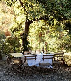 Maybe a metal bistro set ( to replace round wooden set) and put where the swing is under the tree.