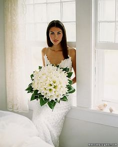 Lush White Bouquet Dozens of Easter lilies, framed by hosta, become mere petals in this generous arrangement. Lily Bouquet Wedding, Calla Lily Bouquet, Bridal Bouquets, White Lily Bouquet, Calla Lily Boutonniere, Calla Lillies, White Lilies, All White Wedding, Floral Wedding