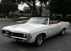 1969 Impala SS, with a factory 427.  My first car and boy, she would FLY. My boyfriend taught me how to change the oil, sparkplugs, and other maintenance. I loved burying the needle on that car...still have a heavy foot.  Great car.  <3
