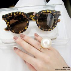 Sunnies and a mani.