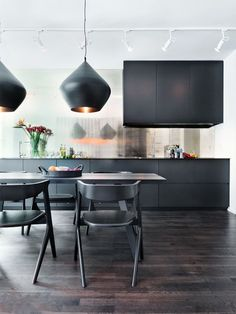 cabinet spacing (sleek, close, no hardware);  big, deep drawers for bases instead of cabinets - sexy black kitchen!