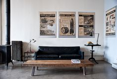 all in neutrals, more industrial: sleek couch, scientific posters, radiator, industry lamps