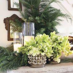 In anentry hall,ahellebore arrangement designed byRaegan McKinneygatherin gold-bronze vases by Accent Decor. Theinterioris by Vision Design.