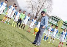 PDPs Anantnag constituency candidate Tasaduq Mufti playing football with Khelo India Khelo football players at Pologround in Srinagar .           -Excelsior/ Shakeel