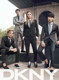 Cara Delevingne proves she can cut it with the boys as she sports a stylish androgynous su...