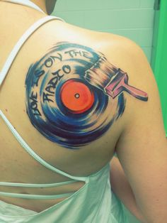 Painted record tattoo I got yesterday! Quote Love is on the Radio by Mcfly!