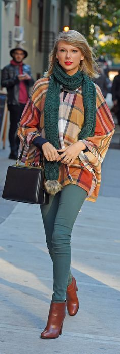 Do as Taylor Swift does and buy your plaid poncho at Topshop.