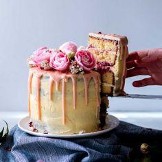 Lemon, almond & raspberry cake with lemon cream cheese buttercream frosting & pink white chocolate ganache drips. GF option.