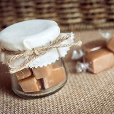 Rustic wedding favour jar. Decorated with ivory fabric and twine tie.