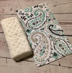 A personal favorite from my Etsy shop https://www.etsy.com/listing/576397867/baby-burp-clothsmint-greengray-paisley