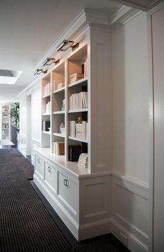 Gorgeous (white) built-in bookshelves. Excellent millwork, hardware, lighting.