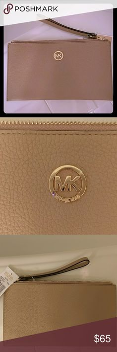 Michael Kors NEW wristlet New with tags. Appox 10X6. Zipper closure. 6 slots for cards, and an additional large pocket. Sorry, no trades. Michael Kors Collection Bags Clutches & Wristlets