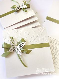 green butterfly wedding invitation    I love the simplicity of this and the 'damask' like emobossing is a nice touch!