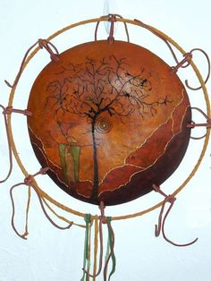 """Wuertz Festival - Wall plaque made from a large gourd base - from """"Medicine Shield"""" class by Shelley Fletcher and Margaret Sullivan."""