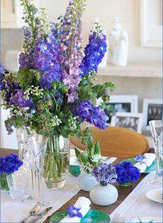 Floral Arrangements Centerpieces | Colorful floral arrangements and table centerpieces in glass vases