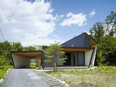 Lodge of Yatsugatake is a minimal home located in Negano, Japan, designed by MDS. Lodge is located at the foot of the Southern Alps overlooking Yatsugatake. The fan-like home is arranged toward the South in order to utilize as much natural sunlight as possible in the winter. The architects wanted to assimilate the interior with the natural surrounding landscapes. As a result, wooden panels can be seen throughout the home's ceilings, floors, and outlining of the walls.