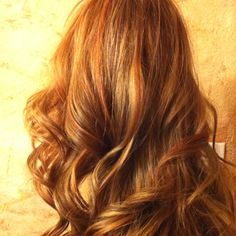Coloring over bleached hair with a medium brown, copper red and caramel highlights. This will give you warmth and texture to your layered hair.