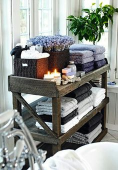 Old wooden shelf recycled into bathroom storage.