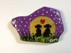 Hand painted rock - Dachshunds by Phyllis Plassmeyer