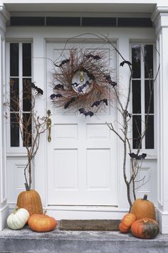 Hang a rustic spooky wreath from your door. Use vines and chic black bats. As simple as that.