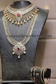 Jewellery Designs: Diamond sets and Bangles by Hiya