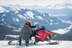 Snowmobiling Proposal in Colorado Mountains Woman on Snowmobile