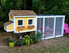 It's a chicken coop with **window boxes** people. Adorable!