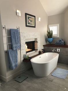 Stacked Stone Surround Gas Fireplace And Jacuzzi Celeste Soaking Tub, Jatoba
