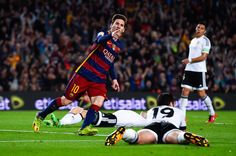 Lionel Messi of FC Barcelona celebrates after scoring his team's first goal during the La Liga match between FC Barcelona and Valencia CF at Camp Nou on April 17, 2016 in Barcelona
