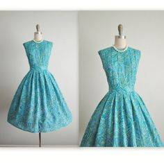 Vintage 1950's Paisley Turquoise Garden Party Day Dress: * Classic silhouette * Turquoise paisley print fabric * Pintucked bodice * Full skirt with matching sash *