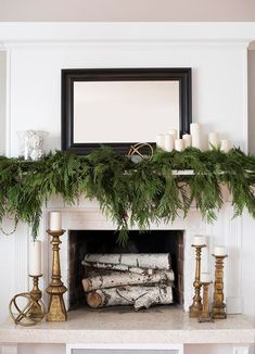 Go for timeless sophistication with this beautiful mantel display from Room for Tuesday. An abundance of greenery and white and gold accents come together as decor that will last through the New Year.