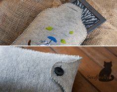 Totoro Kindle case (3/3) - A soft pillow-like Kindle case consisting of wool felt and a lot of yarn. I think she embroidered with yarn! Love the wool felt and use of blanket stitching. Good pattern for the flap (all connected) & button closure.