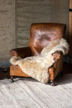Using only the highest quality natural sheepskin from Australia and New Zealand, our natural rug brings superior texture, superior comfort and superior Sheepskin Throw, Farmhouse Side Table, Interior Decorating, Interior Design, Natural Rug, Take A Seat, Club Chairs, Leather Sofa, Wool Rug