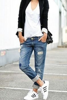 About as cool as it comes in the kick back category. Long black blazer, sleeves partially rolled, over a v neck white tee shirt. Distressed boyfriend jeans with a perfect roll and classic sneakers. Style Planet