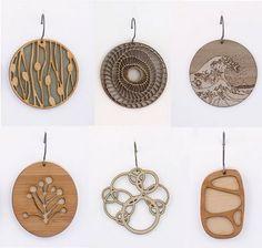 AMAZING laser cut jewelry http://www.mollymdesigns.com/