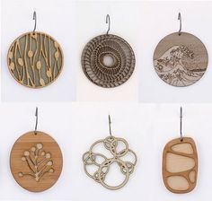 AMAZING laser cut jewelry http://www.mollymdesigns.com/
