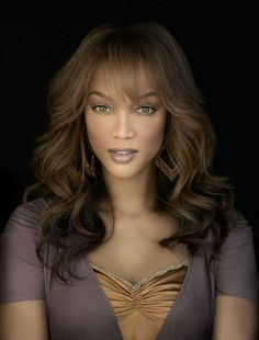 Tyra Banks- for being a black woman in a man's world and speaking up for women's rights, body confidence and upholding the looks and brains mantra :) Loved her show too!>