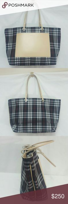 """Burberry Nova check black canvas leather tote Burberry purse in mint condition. Canvas and leather, front slide pocket, no closure; 4.5"""" depth, 14"""" wide, 5.7"""" strap drop, 8.5"""" tall. Made in Italy. Thank you Burberry Bags Totes"""