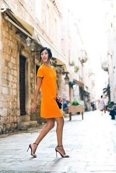 Bright orange shift dress + black strappy heels
