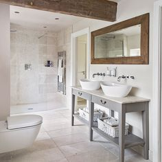 Neutral tiled bathroom with wooden beams | Bathroom decorating | Ideal Home | Housetohome.co.uk
