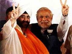Narendra Modi with Manmohan Singh's brother