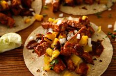 Tacos Al Pastor Ingredients      1 teaspoon whole cumin seeds     3 whole cloves     1/2 teaspoon dried mexican oregano leaves     5 dried guajillo chiles     5 dried chiles negros (also called pasilla negro)     2 dried ancho chiles     1 (3-pound) pineapple (about 1 1/4 pounds fresh pineapple meat)     1 large white onion     2 medium garlic cloves, peeled     2 tablespoons cider vinegar     2 tablespoons freshly squeezed lime juice (from about 1 medium lime)     2 teaspoons kosher salt…