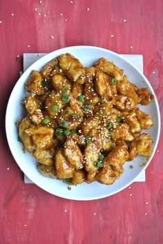 Crunchy Chicken Tossed In A Spicy Asian Inspired Sauce Packed With Sesame Oil Sriracha And Soy Sauce Impressive Enough For Guests But Easy Enough For A