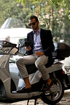 Italian style. So many men roll their pants up to the ankles like that. Never saw that in America. #italianfashion