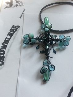 *Farygarden*  wire work cross with blue glas pearls and black wire  my own Work made with love <3