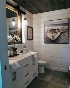 Shiplap bathroom walls have taken the design scene by storm in the past five years. Shiplap creates the classic rustic look that is well-loved by designers and home DIYers alike. Shiplap is affordable and easy to install! Shiplap Bathroom Wall, Bathroom Renos, Bathroom Renovations, Home Remodeling, Remodel Bathroom, Bathroom Cabinets, Lake House Bathroom, Shiplap Wall In Bathroom, Small Cabin Bathroom