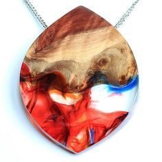 One of my favorite pieces! Made from 5 different colors of resin and some beautifull wood. www.woodallgood.etsy.com