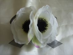 Pretty corsage for the moms? I like having poppies to remember my Poppy.